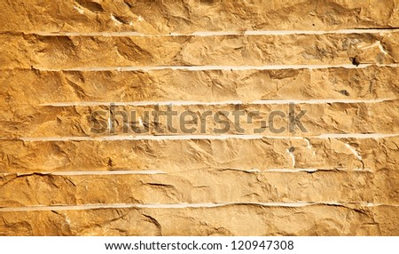 Close up of a brick-wall, texture background. Pattern gray color of cracked real stone wall surface with cement - stock photo