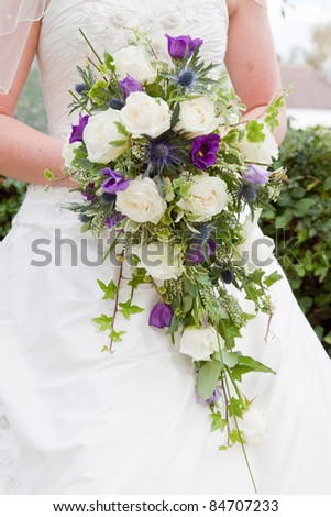 Close-up of a bride holding her bouquet