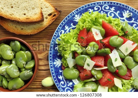 Close up of a broad beans salad with tomato and goat cheese - stock photo