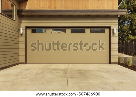 Close Up Of A Brown Garage Door That Is Closed