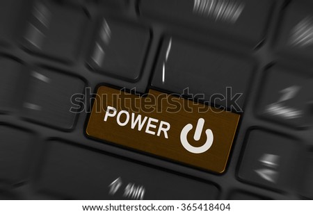 Close-up of a brown power button on a black laptop keyboard