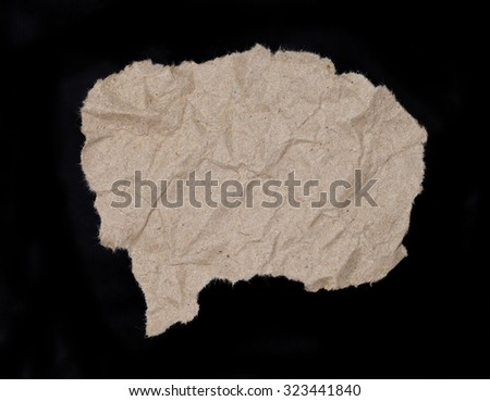 close up of a brown ripped piece of news paper on on black background with clipping path - stock photo