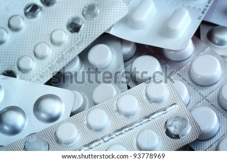 Close up of a bunch of pharmaceutical pills