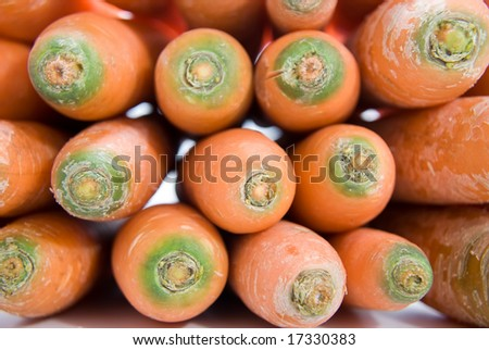 Close up of a bundle of freshly harvested carrots. - stock photo