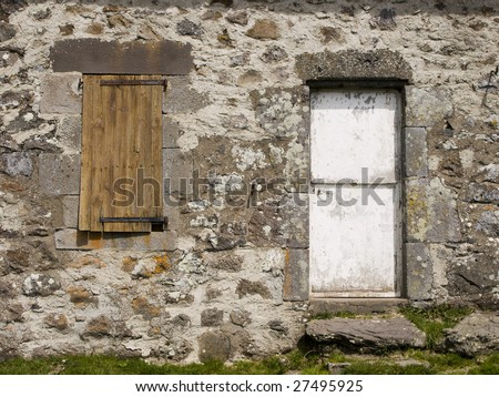 Close-Up of a Buron in Cantal (Auvergne) : window and door of this traditional shepherd hut.