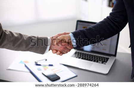 Close-up of a business handshake Laptop