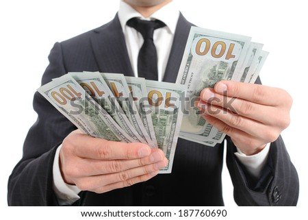 Close up of a business man hands counting banknotes isolated on a white background