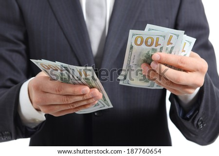 Close up of a business man hands counting money isolated on a white background - stock photo