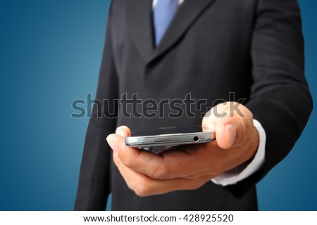 Close up of a business man holding mobile smart phone  - stock photo