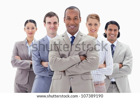 Close-up of a business team smiling and crossing their arms against white background - stock photo