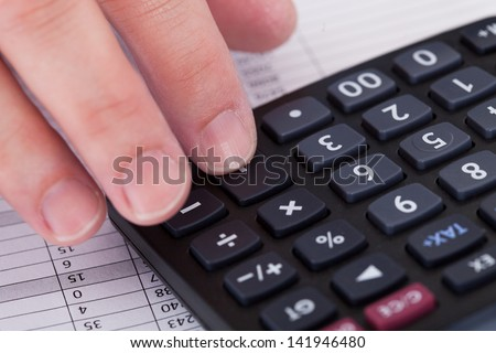 Close-up Of A Businessman Doing Accounting Work - stock photo