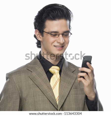 Close-up of a businessman looking at a mobile phone - stock photo
