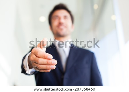 Close-up of a businessman offering an handshake - stock photo