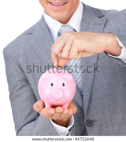 Close-up of a businessman saving money in a piggybank against a white background - stock photo