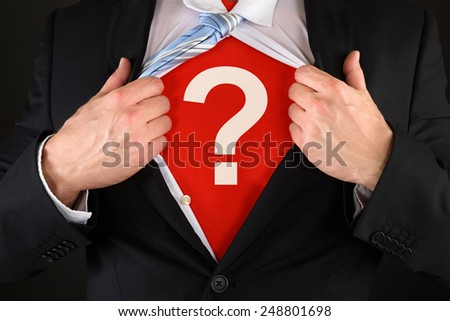 Close-up Of A Businessman Showing Question Mark Symbol Under His Suit - stock photo