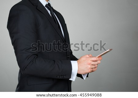 Close up of a businessman using mobile smart phone - stock photo