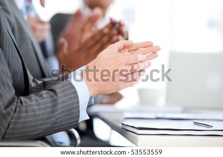 Close-up of a businessteam applauding a presentation in the office - stock photo