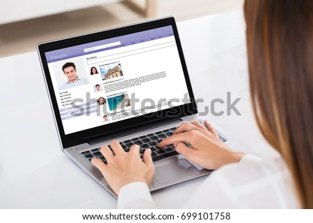 Close-up Of A Businesswoman Chatting On Social Website With Laptop