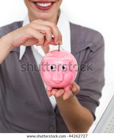 Close-up of a businesswoman saving money in a piggybank isolated on a white background