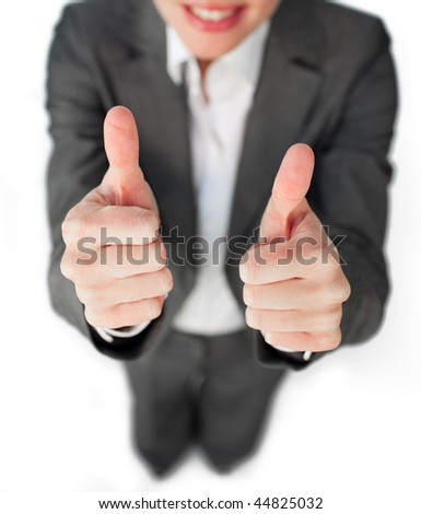 Close-up of a businesswoman with a thumbs up isolated on a white background