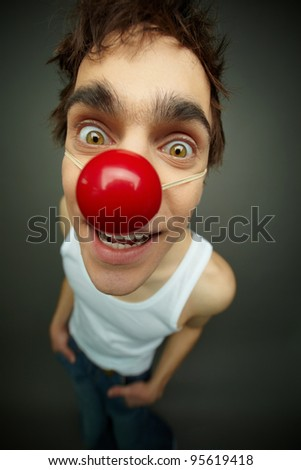 Close-up of a buy looking at camera with a smile, all fool�s day - stock photo