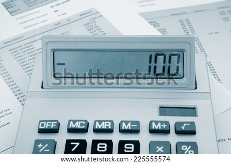Close up of a calculator on a bank statement - stock photo