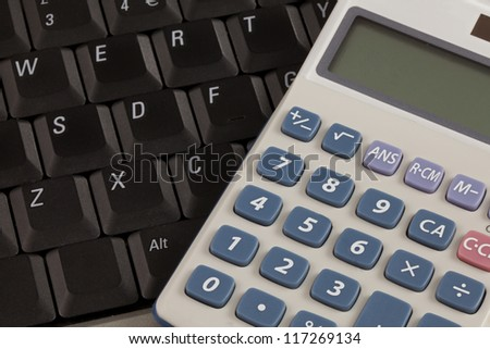 Close up of a calculator on a laptop keyboard