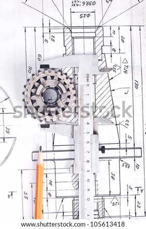 Close up of a calliper against the engineering project - stock photo