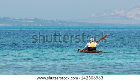 close up of a canoeist in Sardinia