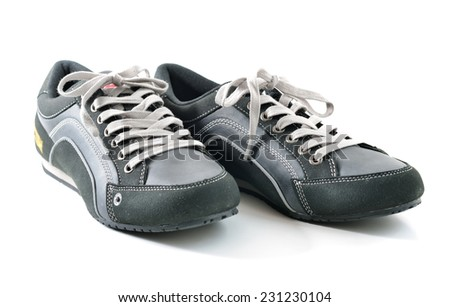 Close up of a casual man shoes isolated on white background, selective focus.  - stock photo