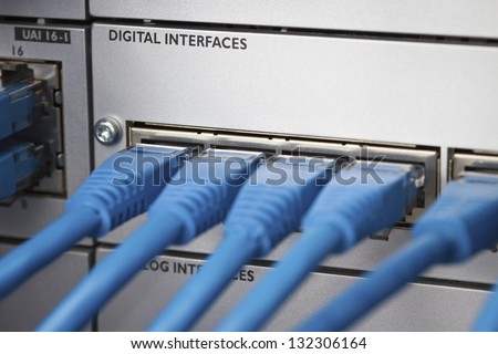 Close up of a cat 5 / 5e / 6 patch cable into a PBX (Private Branch Exchange) switch station for telephone systems. - stock photo