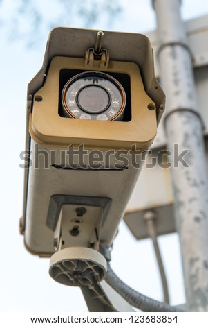 Close-up of a CCTV surveillance camera, spying on people. - stock photo