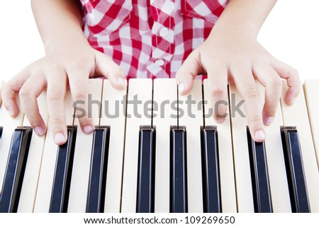 Close-up of a child hand playing the piano - stock photo