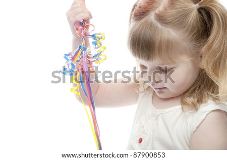 close up of a child playing with balloon strings