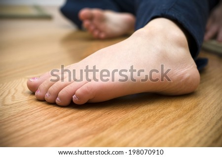 Close up of a child's foot - stock photo
