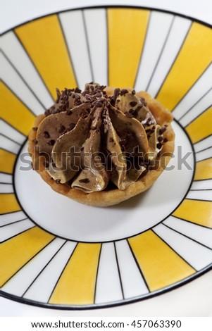 Close up of a chocolate cream cake on a stylish plate - stock photo