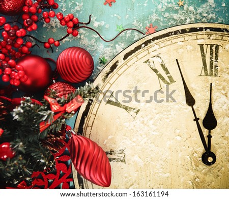 Close up of a Christmas clock and fir branches covered with snow - stock photo