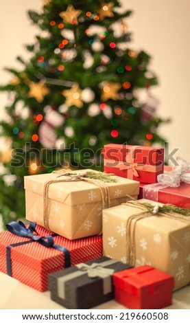 Close up of a Christmas gifts - christmas tree in the background - stock photo