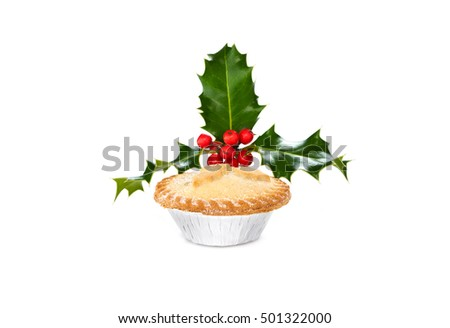 Close up of a Christmas Mince Pie and holly sprig isolated on a white background. Sweet Mince Pies, fruit filling.