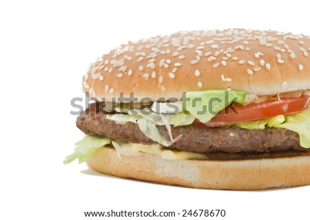 Close-up of a classic hamburger isolated against a white background.