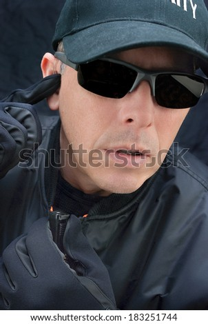 Close-up of a close protection officer reporting. - stock photo
