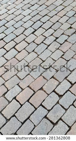 Close up of a cobblestone paved road in Europe as a background texture - stock photo