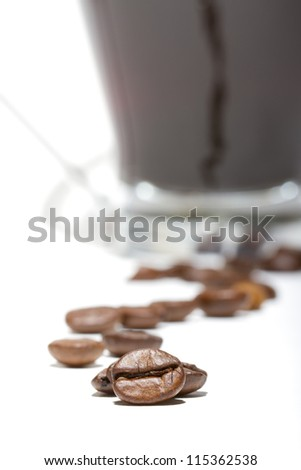 Close up of a coffee beans on a white background