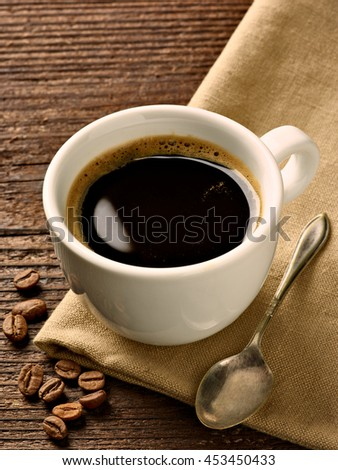 close up of a coffee cup on wooden background