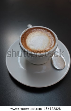 Close-up of a coffee cup with milk foam