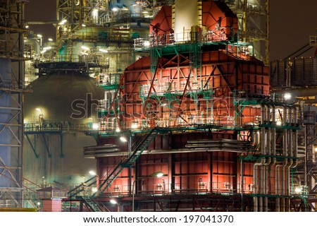 Close-up of a coker unit of an oil-refinery plant at night - stock photo