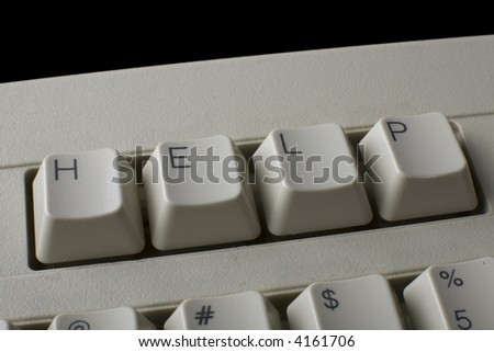 "Close up of a computer keyboard with the word ""HELP"" in place of the first set of function keys."