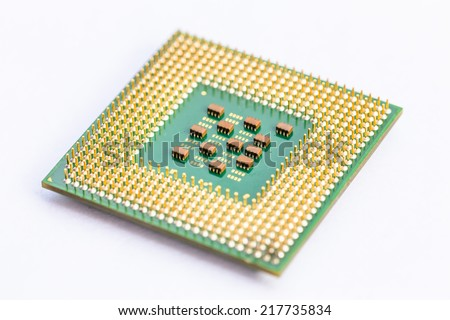 Close-up of a computer processor microchip between the fingers and isolated on a white background - stock photo