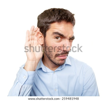 Close up of a concerned guy with gesture of not listening - stock photo
