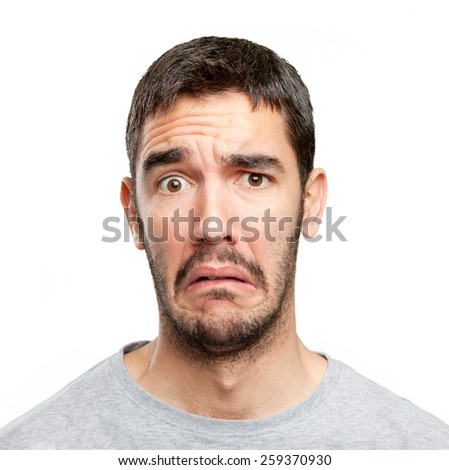 Close up of a concerned man - stock photo